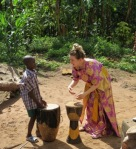 Laura teaches some rhythms in traditional Ugandan attire